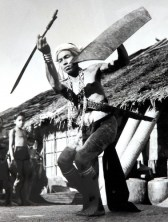 A war dance by a Dyak warrior in Sarawak, 1954