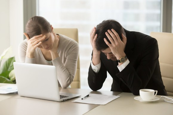 frustrated computer business people.jpg