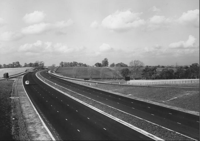 The M1, when it opened in all it's three lane glory back in 1959 - note the lack of crash barriers and even speed limits!