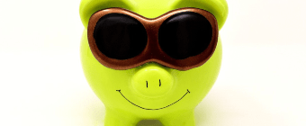 piggy bank with sunglasses - representing azure cost optimisation