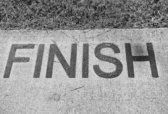 Finish line on pavement black and white