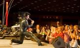 Elvis look-alike sings to party guests