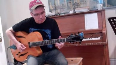 John tries out a new guitar