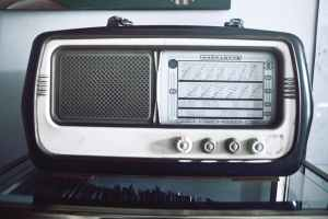 grayscale photography of gray and black magnadyne transistor radio
