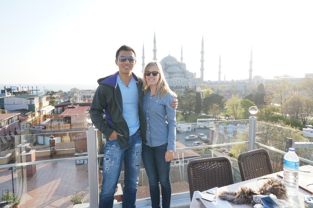 Getting our picture taken with the Blue Mosque