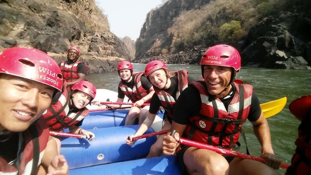 Getting a picture in between rapids. Note we are all smiles here but this was not the case while flipping...