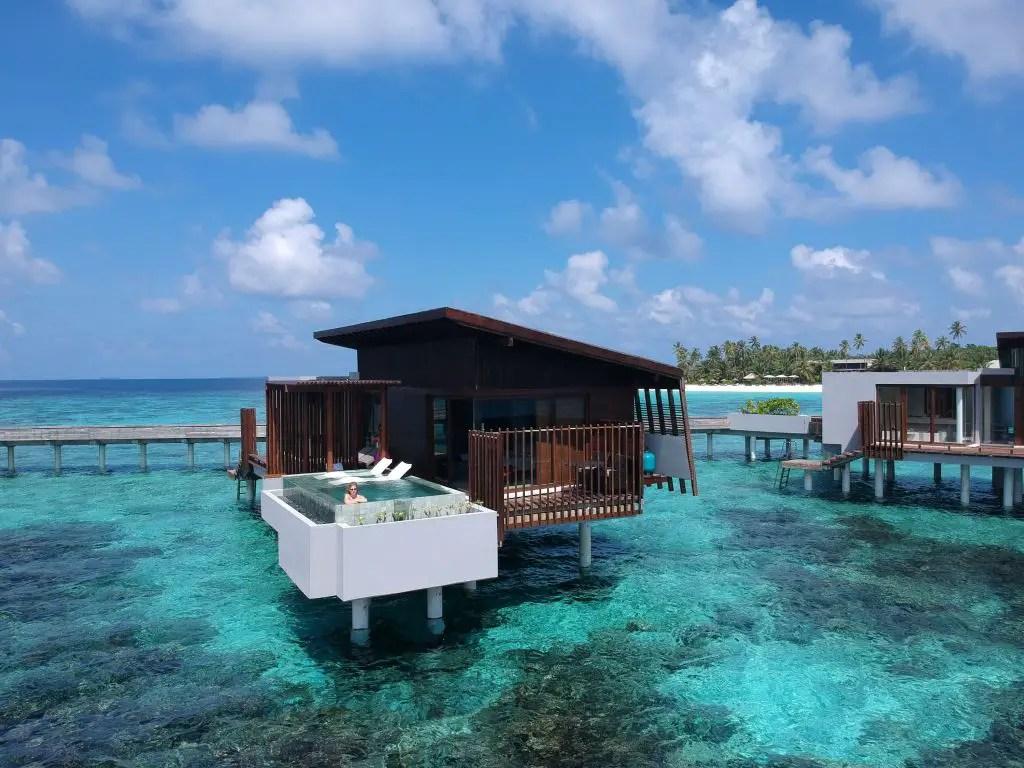Maldives overwater sunset villa park hyatt hadahaa drone