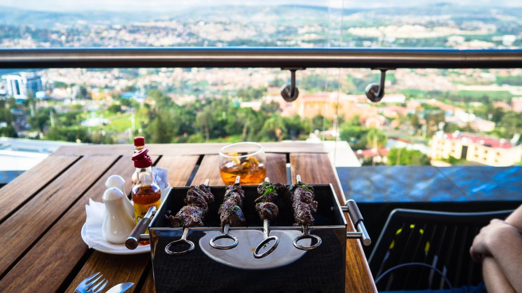 Eating lunch with a view at the rooftop hotel Ubumwe hotel Kigali rwanda