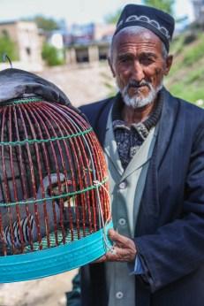 Man selling birds Istaravshan Tajikistan-5547