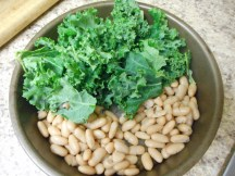 Put the beans and kale in a pan and heat in oven in the last 5 minutes of cooking.