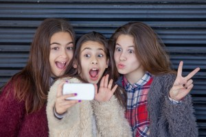 kids selfie with cell smart or mobile phone