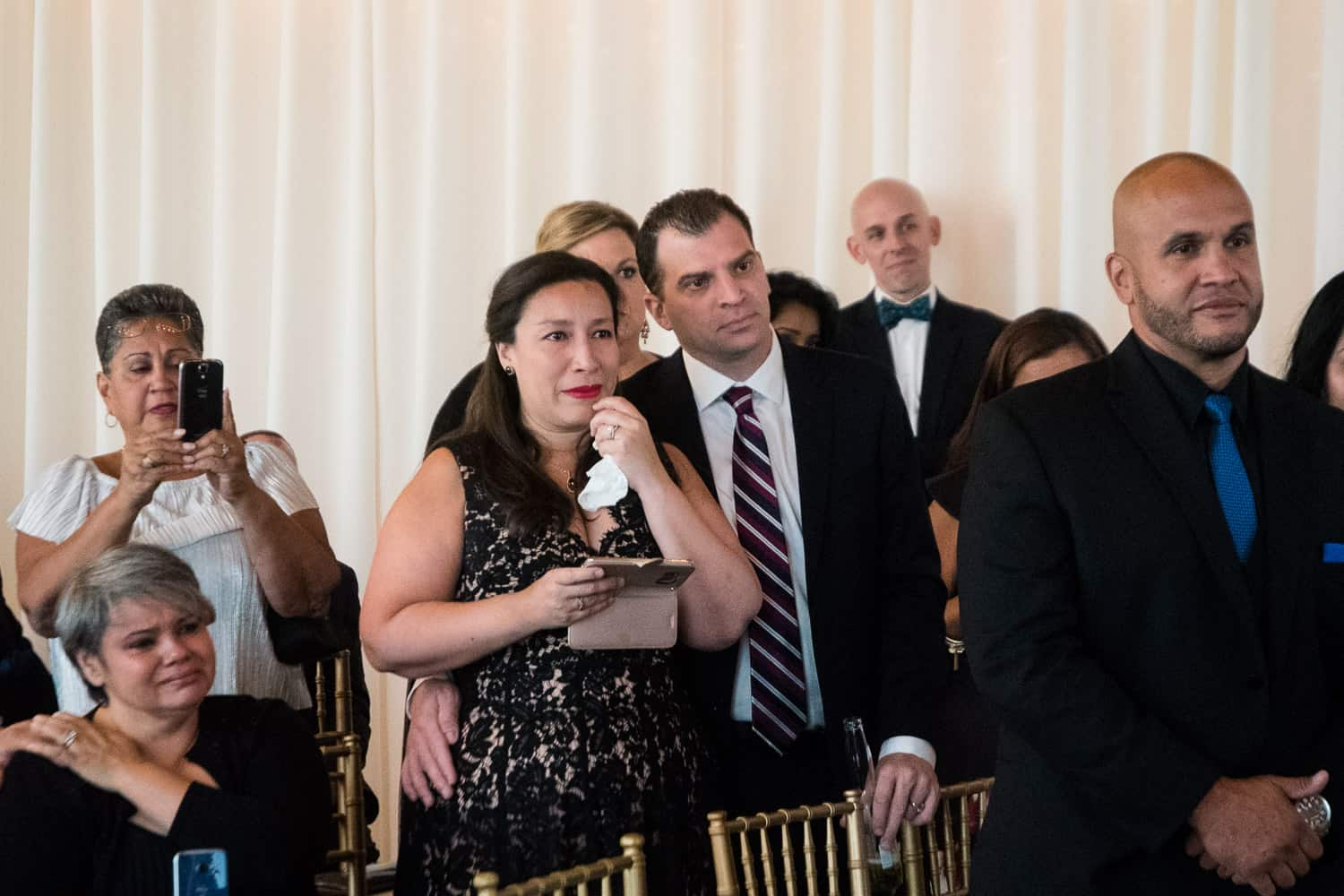 Audience members cry at an Arbor Loft Wedding.