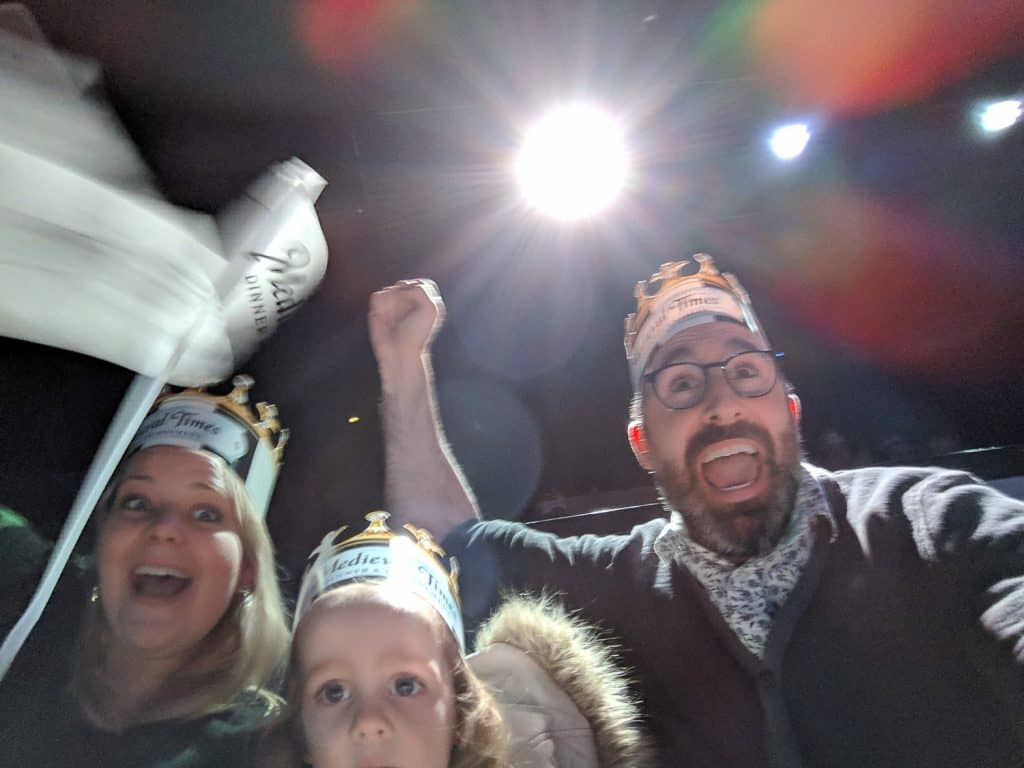 John Schlia and family cheering at Medieval Times in Toronto