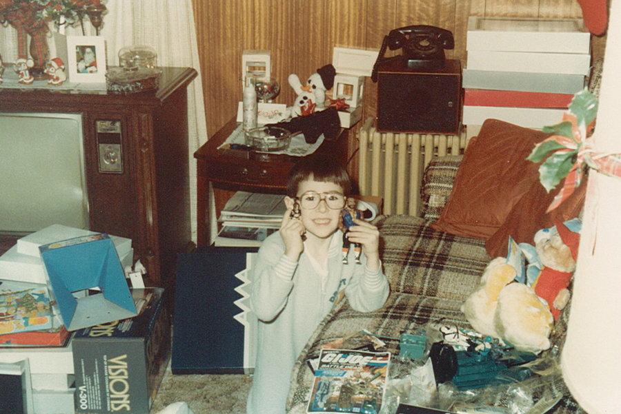 4 or 5 yr old John in a PJ onsie holding Mr. T action figure.