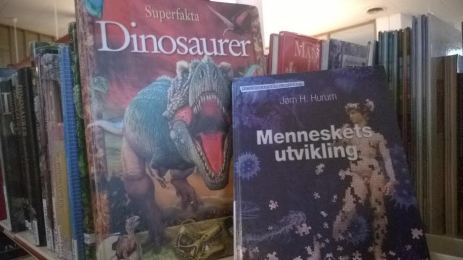 Two books about dinosaurs and the evolution of human beings