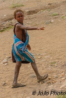 Maasai boy by highway in Tanzania