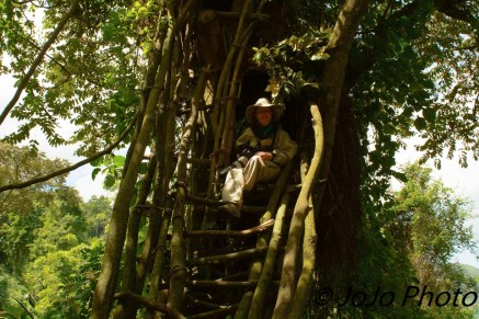 Mary exiting Batwa Pygmy Treehouse in Bwindi National Park