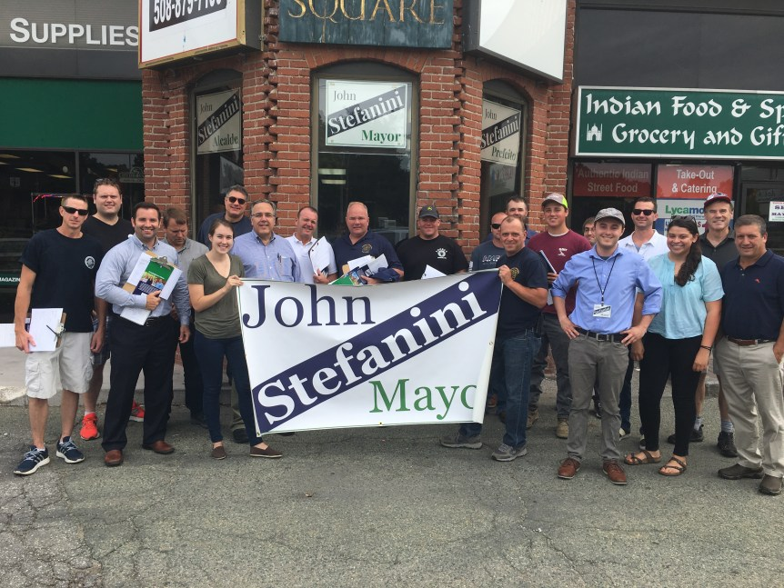 John Stefanini stands with local union members.