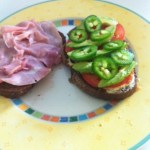 Pumpernickel, tomatoes, jalapenos, avocado slices, grey poupon mustard. OMG!