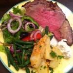 Prime rib roast, roasted potatoes, green beans, Greek salad, and creamed horseradish