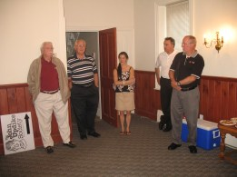 Civic leaders gather in the dining room before deconstruction begins.