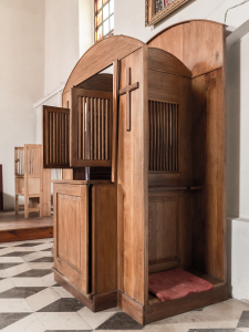 Wooden confessional in catholic church