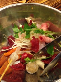 Help yourself to ingredients for a mini hotpot
