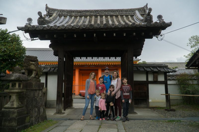 Family standing at entrance to bloody temple