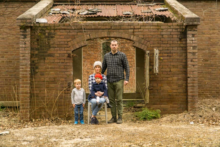 Rabbit Island family in front of ruins