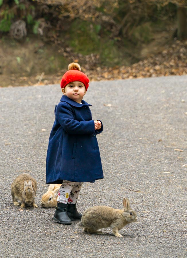 Rabbit Island girl with rabbits