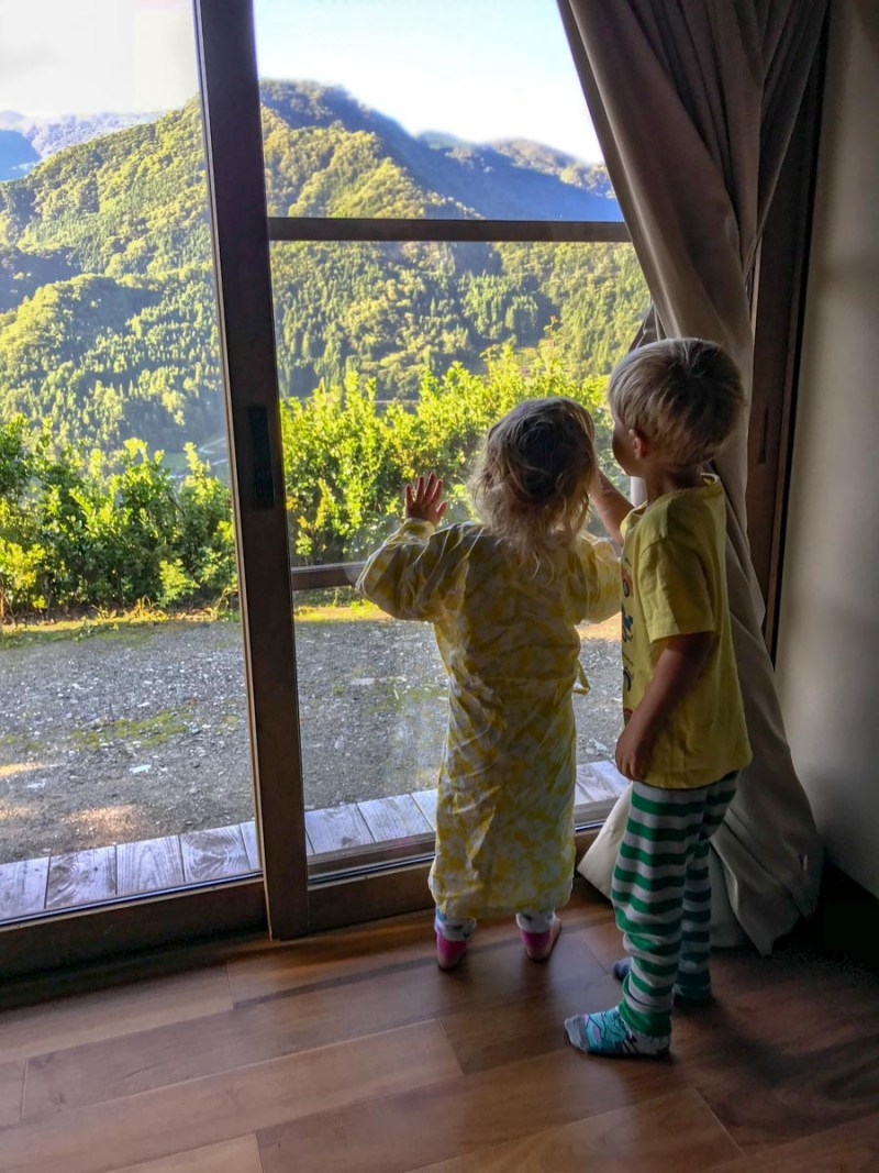 Kids check out the view at the Ochiai Thatch-roof house