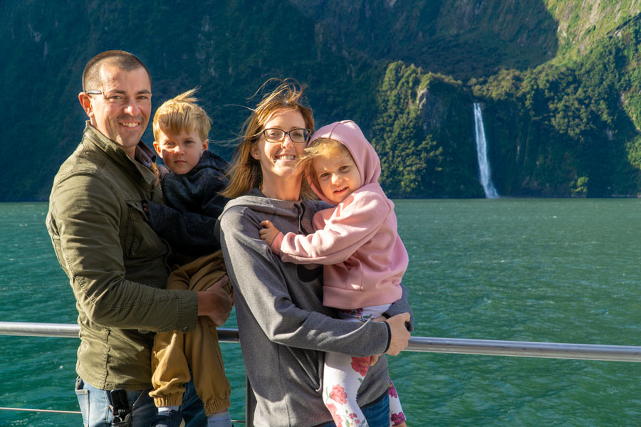 Family on a boat in Milford Sound