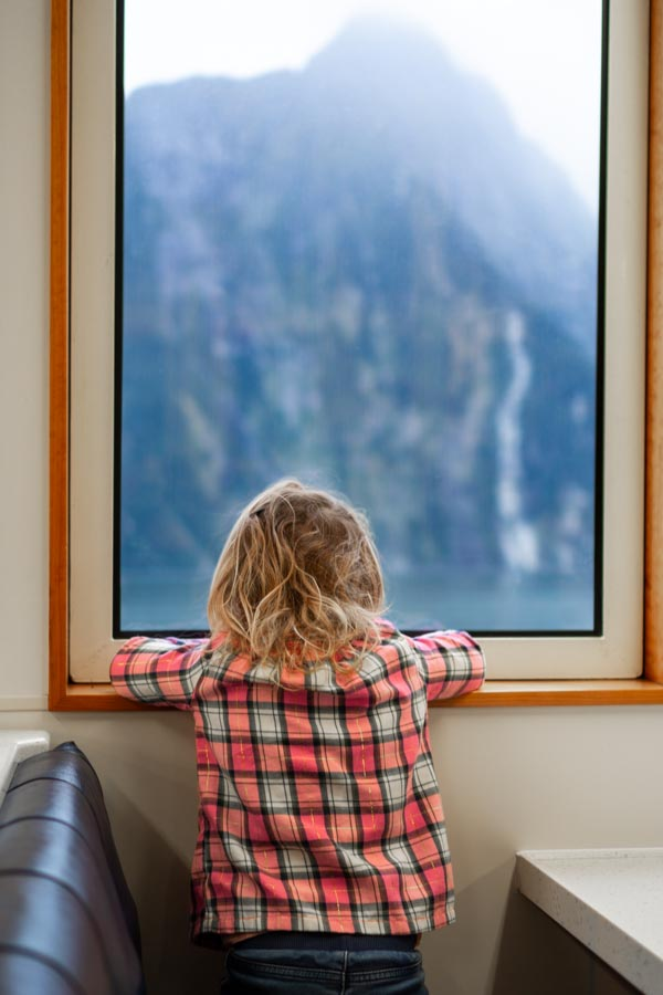 Milford Sound girl viewing out of ship window
