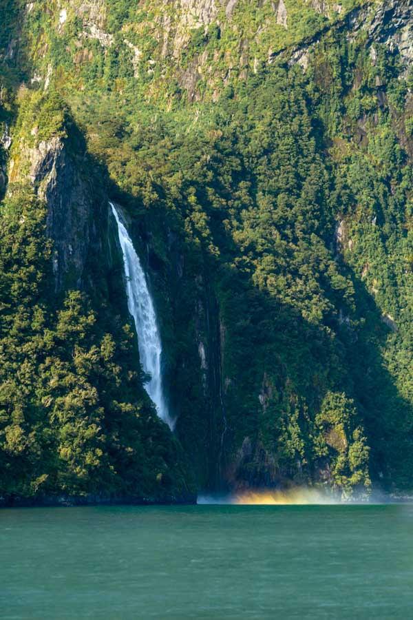 Milford Sound waterfall with a rainbow