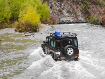 off-roading in New Zealand Nomad Safaris off roading through a river