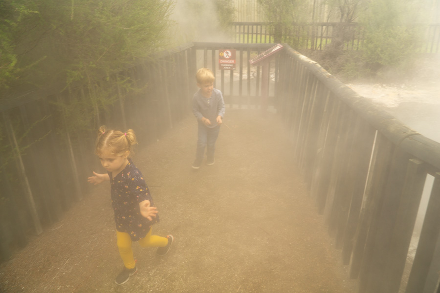 Rotorua kids running through steam