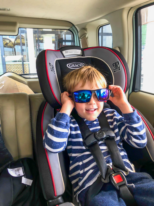 boy traveling in the car seat
