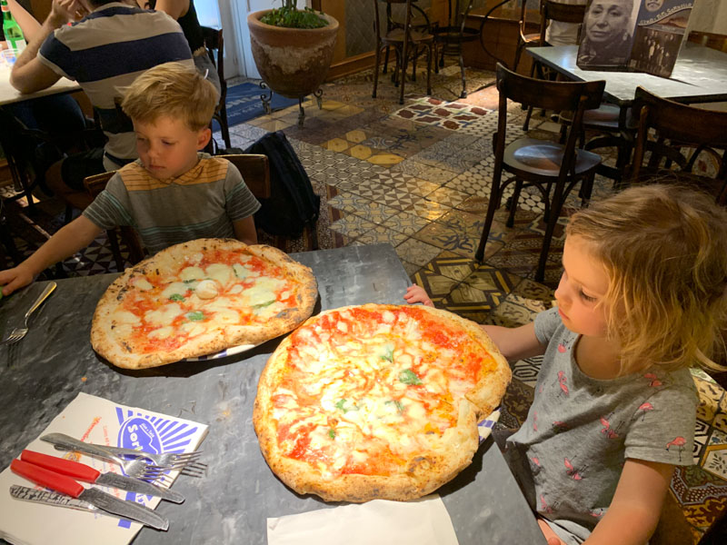 Naples Underground kids with pizza