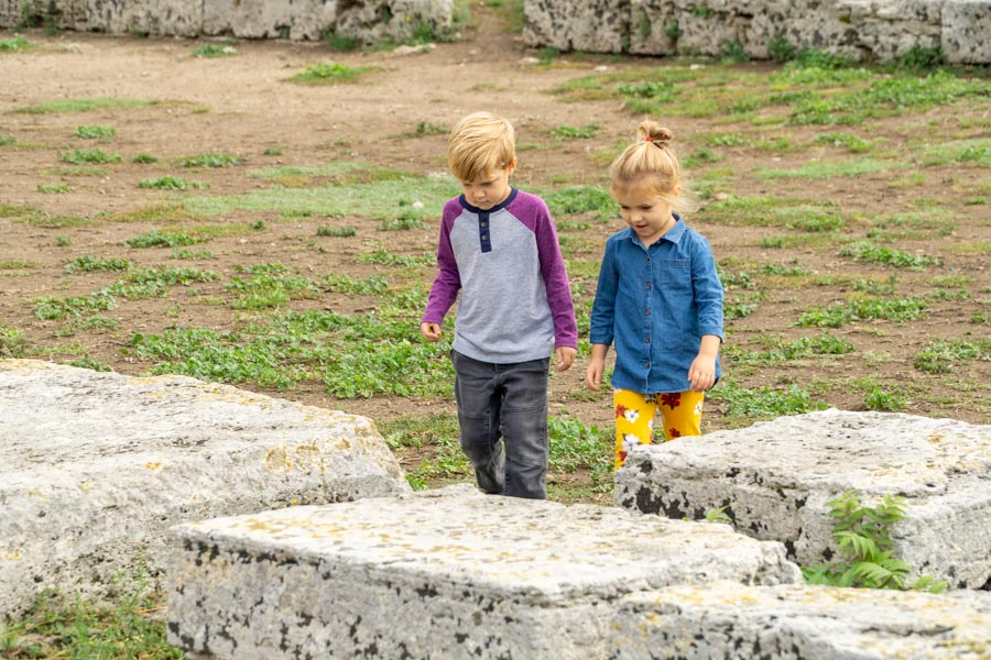 Kids walking through Paestum ruins