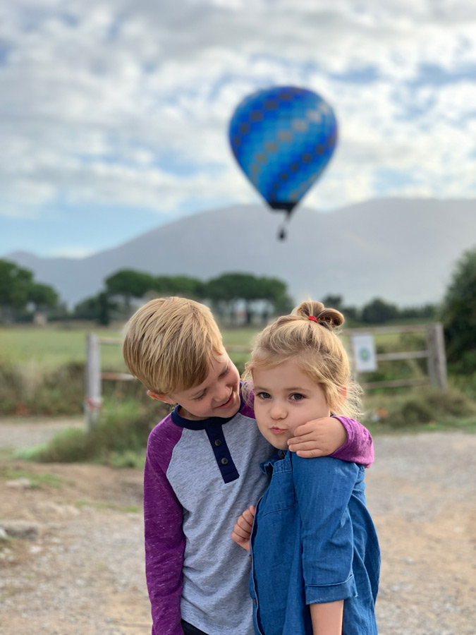 kids in front of a hotair balloon