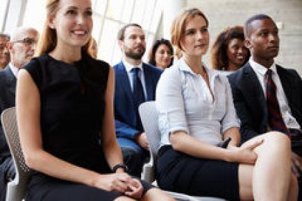 audience-listening-to-speaker-business-conference