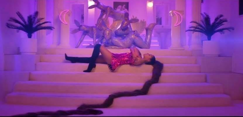 Watch: Ariana Grande Flexes Her Rap Skills, Talks Her Sh-- In New '7 Rings' Video