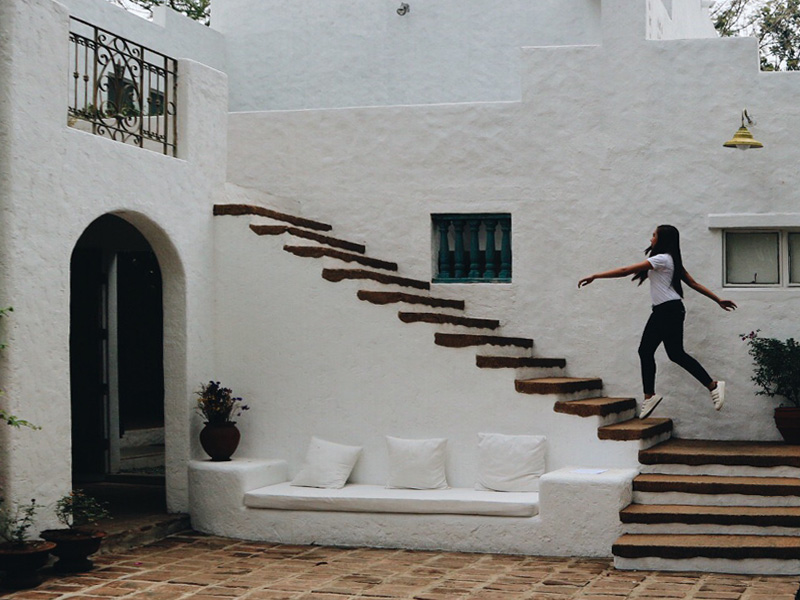 girl levitating over the stairs