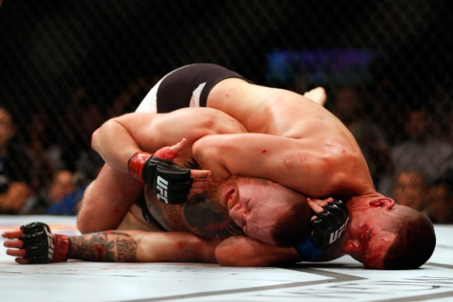 Nate Diaz taps out Conor McGregor during their first pay per view fight in the UFC.