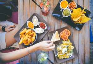 an appetizer spread at an upscale outdoor eatery showing how to prevent a hangover