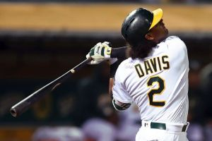 Khris Davis takes a hack wearing a jersey signed by a child from the Make-A-Wish Foundation