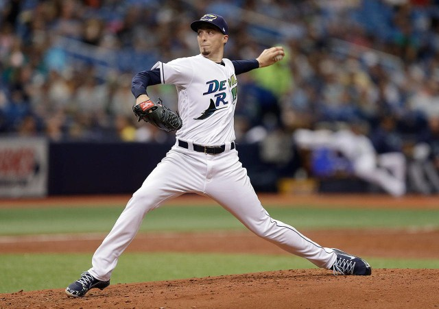 Donning the Tampa Bay Devil Rays throwback uniform, left-handed pitcher Blake Snell fires a pitch in the top of the first inning
