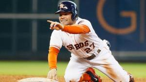 Jose Altuve slides in safely to notch another stolen base for MLB Second Half Storylines AL West