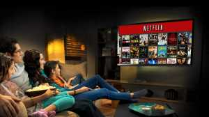 a family tunes into their show after buying a netflix subscription because of the netflix marketing strategy