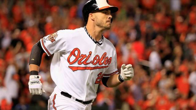 Steve Pearce trots to first base in the postseason for the Baltimore Orioles, surrounded by a packed house of towel-waving fans